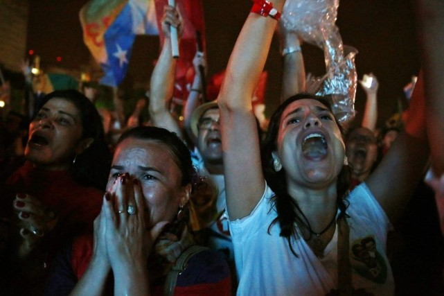 Des partisans de Dilma Rousseffcélébraient la victoire de... (Photo: Reuters)