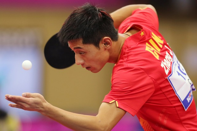 Le pongiste chinois Zhang Jike.... (Photo Eugene Hoshiko, archives AP)