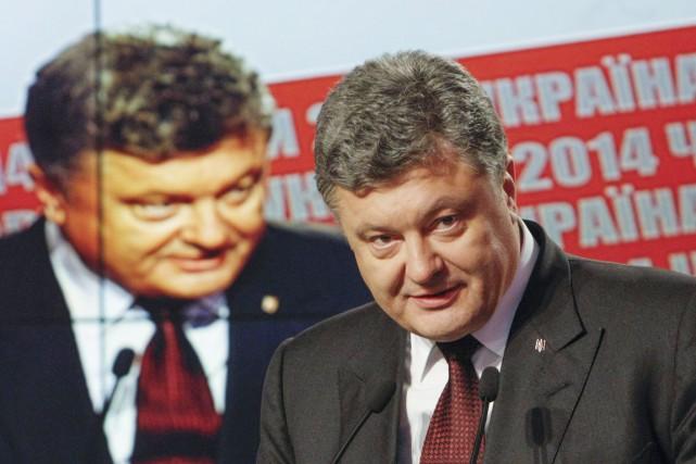 Le Bloc Petro Porochenko (21,41%, ci-dessus) est légèrement... (PHOTO VALENTYN OGIRENKO, REUTERS)