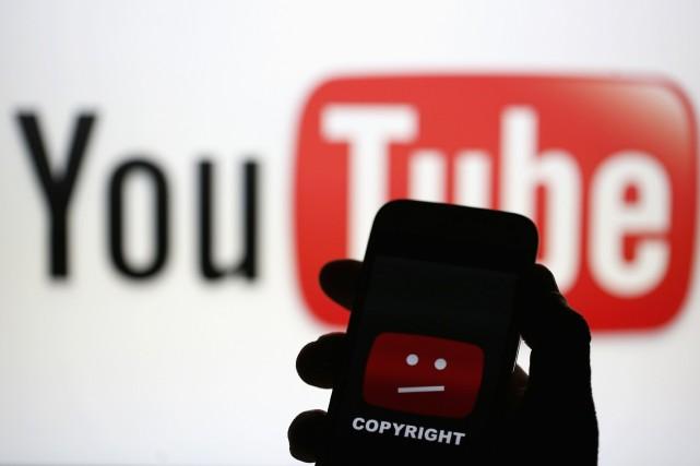 YouTube a évoquécertaines applications qui proposaient à leurs... (Photo DADO RUVIC, Archives Reuters)