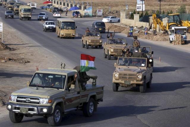 Ce convoi d'une quarantaine de véhicules, chargés notamment... (SAFIN HAMED)