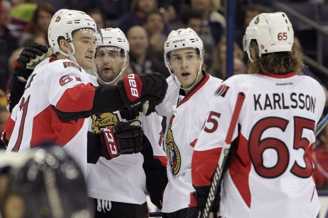Mark Stone, Clarke MacArthur, Kyle Turris et Erik... (Jay LaPrete, Associated Press)