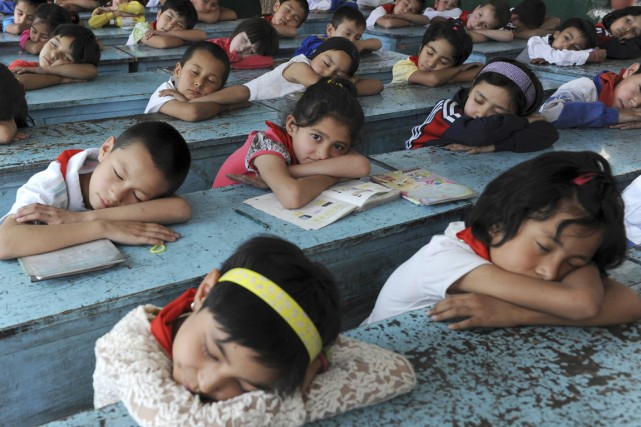 Une élève d'une école du xian d'Akqi, district... (PHOTO ARCHIVES REUTERS/STRINGER)