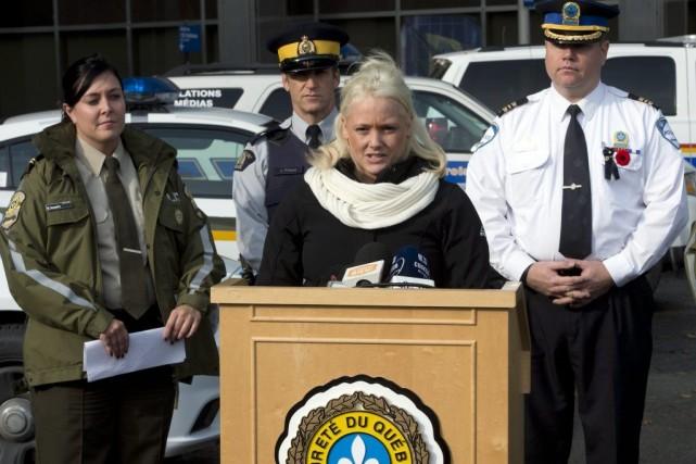 «Protégeons nos enfants tous ensemble. Travaillons ensemble pour... (La Presse Canadienne, Ryan Remiorz)