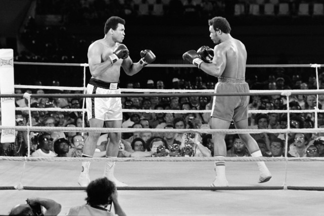 Le combat entre Mohamed Ali et George Foreman... (Photo archives AFP)