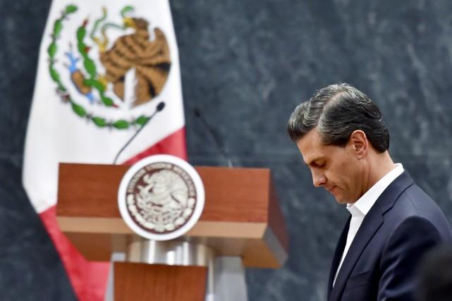 Le président Peña Nieto a expliqué que cette... (PHOTO YURI CORTEZ, AFP)