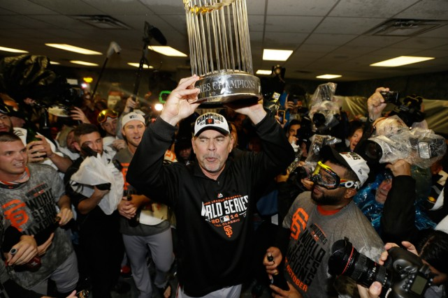 Menés par leur gérant Bruce Bochy (au centre),... (Photo David J. Phillip, AP)