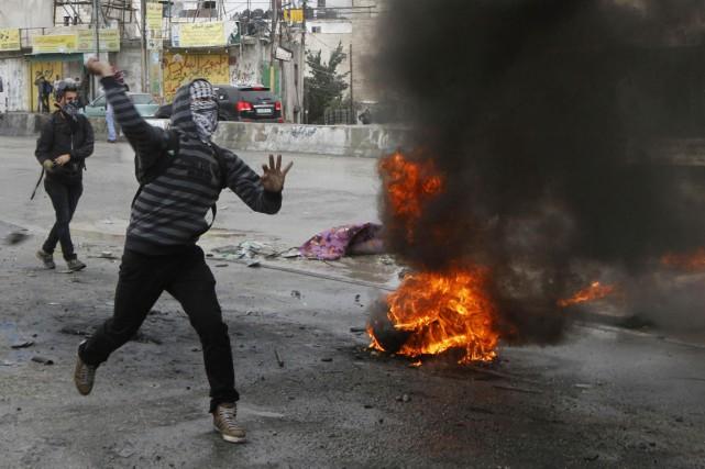 À Qalandiya, la prière de vendredi a été... (Photo Abed Omar Qusini, Reuters)