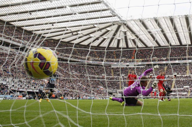 Ayoze a ouvert le score pourNewcastle à la... (PHOTO ANDREW YATES, AFP)