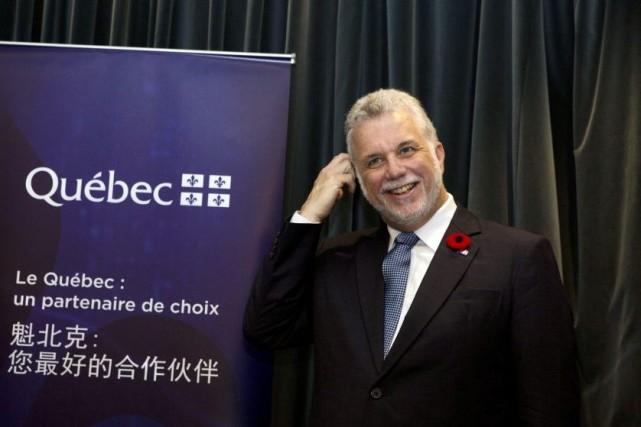 Le premier ministre Philippe Couillard était en Chine... (AP, Ng Han Guan)