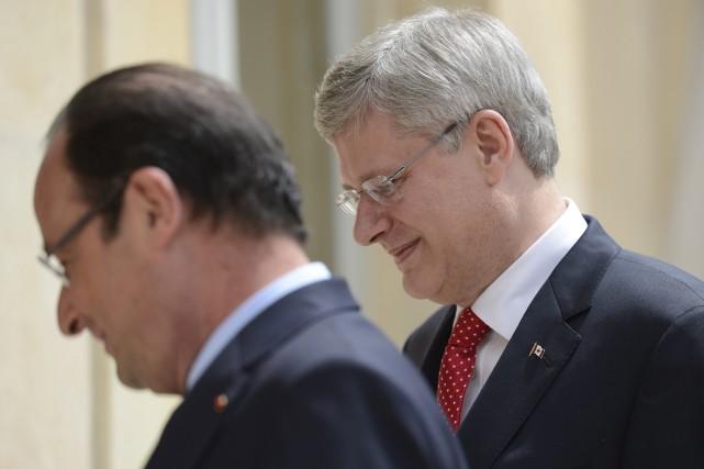 Le président français François Hollande et Stephen Harper... (La Presse Canadienne, Adrian Wyld)
