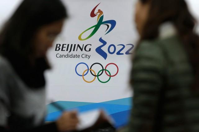 Pékin souhaite devenir la première ville à organiser... (Photo Andy Wong, archives AP)