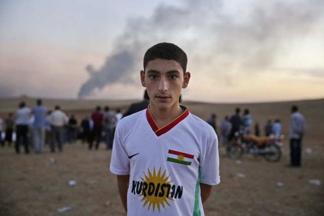 Cet adolescent kurde est venu, comme plusieurs autres,... (PHOTO LEFTERIS PITARAKIS, ARCHIVES AP)