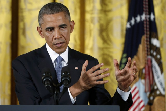 Barack Obama a réitéré sa détermination à agir... (Photo: Reuters)