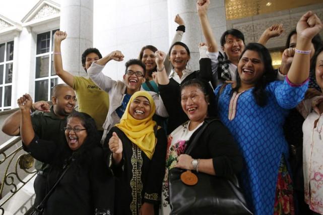 Les Malais musulmans représentent environ 60% de la... (Photo Olivia Harris, Reuters)