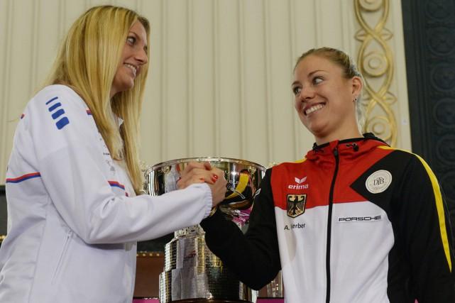 La Tchèque Petra Kvitova et l'Allemande Andrea Petkovic.... (Photo Michal Cizek, AFP)