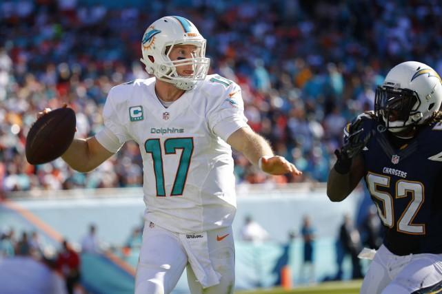 Chez les Dolphins, le quart-arrière Ryan Tannehill connaît... (Photo d'archives, AFP)