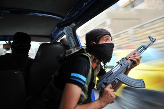 Quelque 15000 djihadistes étrangers provenant de 80 pays... (Photo Bulent Kilic, archives Agence France-Presse)