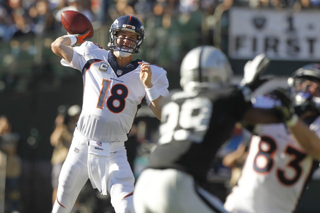 Manning a complété 31 de ses 44 passes... (Photo Cary Edmondson, USA Today Sports)