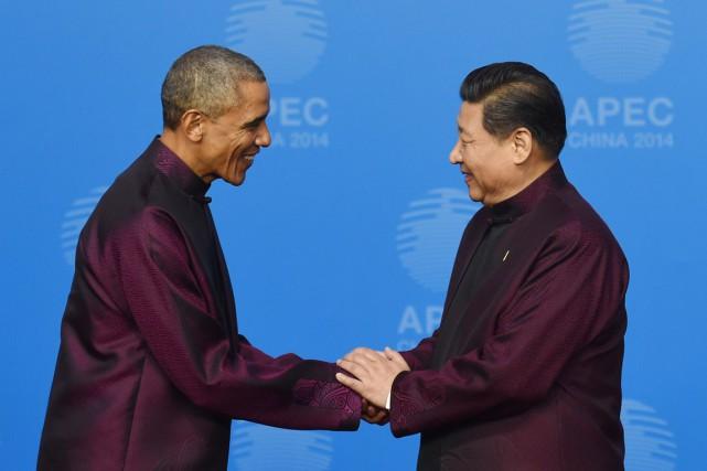 Le président chinois Xi Jinping reçoit son homologue... (PHOTO Greg BAKER, AFP)