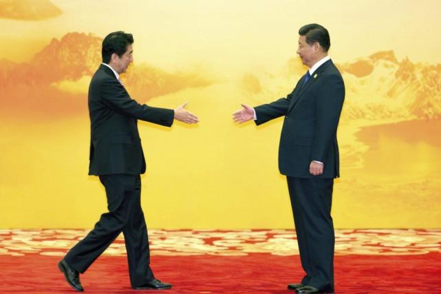 Lundi avait vu la première rencontre formelle entrele... (Photo Ng Han Guan, AP)