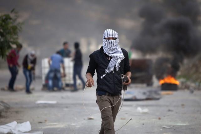 Les soldats israéliens essayaient de disperser environ 150... (Photo: AP)