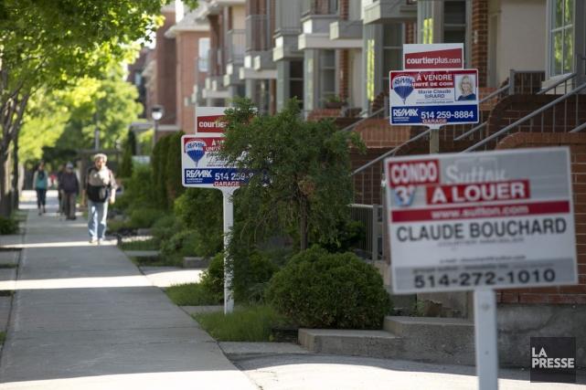 Des courtiers immobiliers et des économistes croient que les hausses de primes... (PHOTO FRANÇOIS ROY, ARCHIVES LA PRESSE)