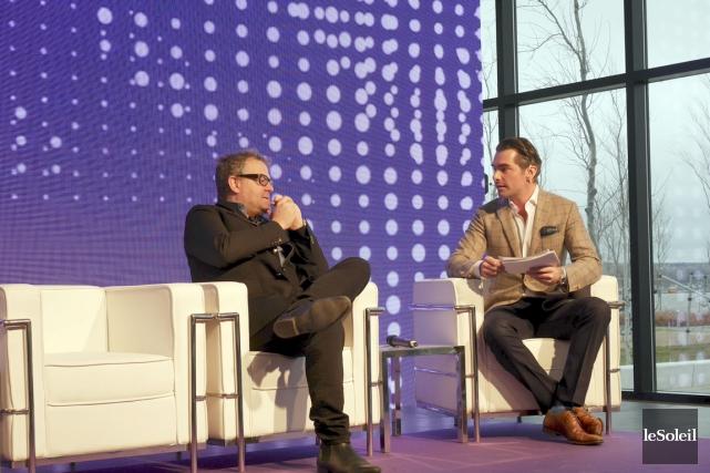 L'homme d'affaires Alexandre Taillefer discute avec l'animateur Jean-François... (Le Soleil, Yves Therrien)