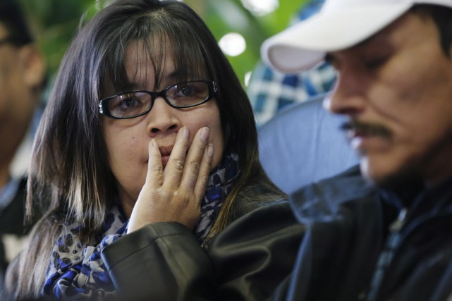 Les parents de la victime, Rinelle Harper.... (Photo JOHN WOODS, La Presse canadienne)