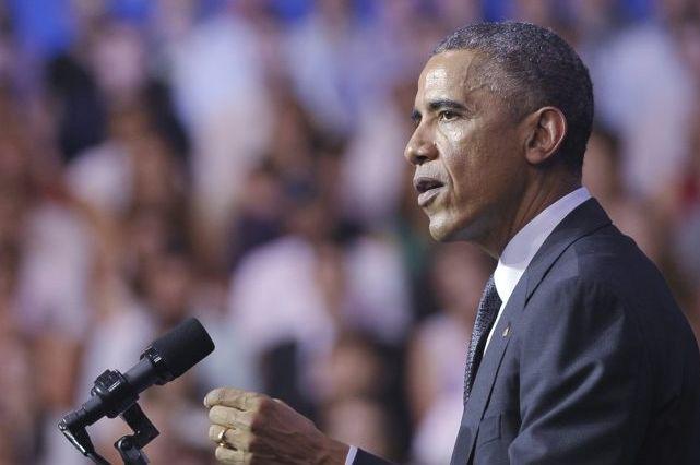 M. Obama a annoncé une contribution américaine de... (Photo MANDEL NGAN, AFP)