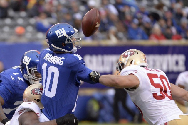 Manning a effectué une passe payante de 19... (Photo USA Today Sports)