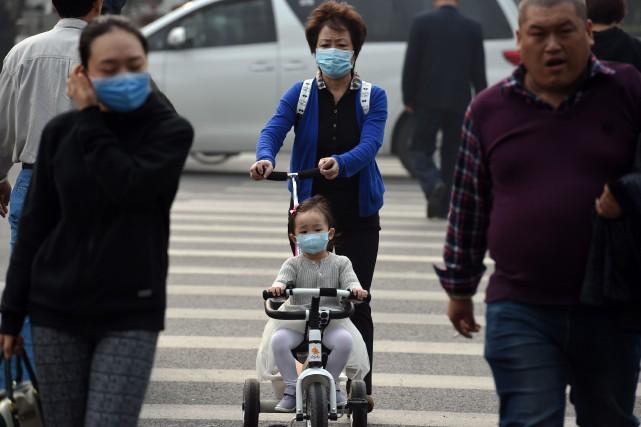 Les épisodes de smog sévères sont fréquents à... (PHOTO GREG BAKER, AGENCE FRANCE-PRESSE)