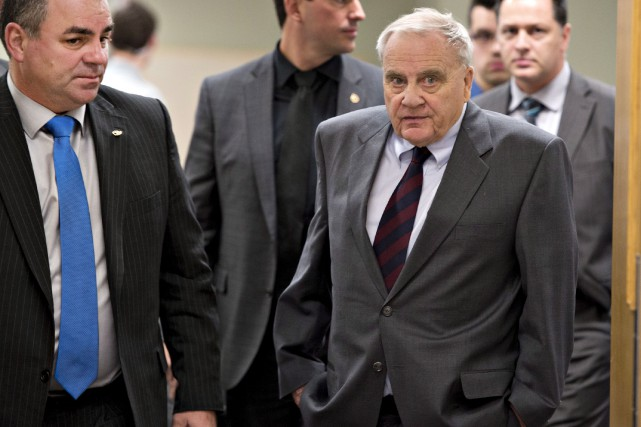 Le coroner Cyrille Delâge (à droite) a émis... (La Presse Canadienne, Jacques Boissinot)