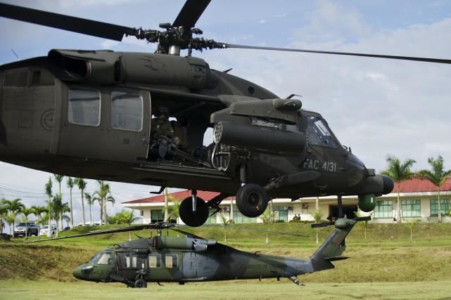 Le président colombien Juan Manuel Santos a annoncé jeudi soir qu'une opération... (Photo LUIS ROBAYO, AFP)