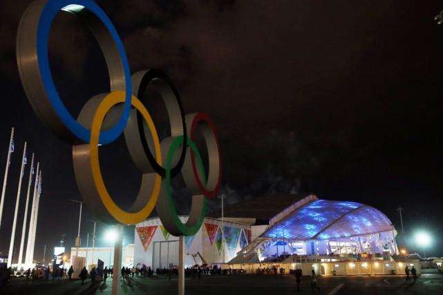 Avec les 50 milliards investis par les Jeux... (Photo Loic Venance, archives AFP)