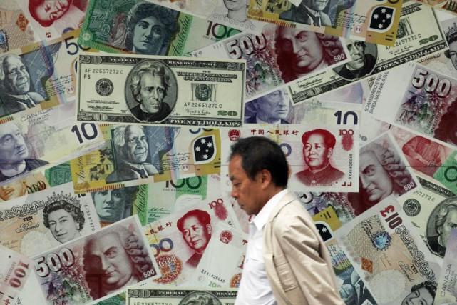 La mesure a électrisé les Bourses mondiales, déjà... (Photo Tyrone Siu, Archives Reuters)