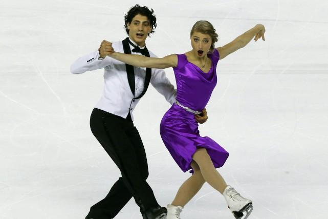 Les Canadiens Piper Gilles et Paul Poirier ont décroché l'argent en danse sur... (Photo Michel Euler, AP)