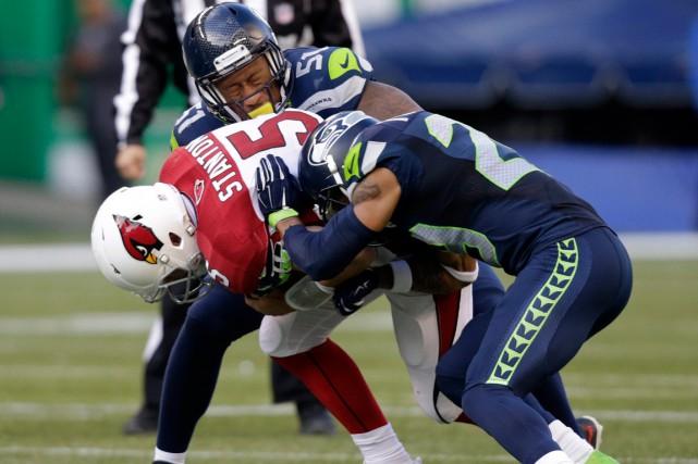 La défense des Seahawks a complètement dominé le... (Photo Stephen Brashear, AP)