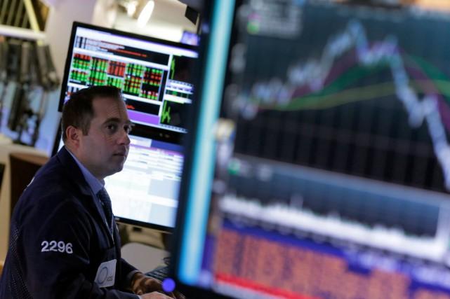 Wall Street a fini en hausse lundi pour la quatrième séance de suite, dans un... (Photo Richard Drew, Archives AP)