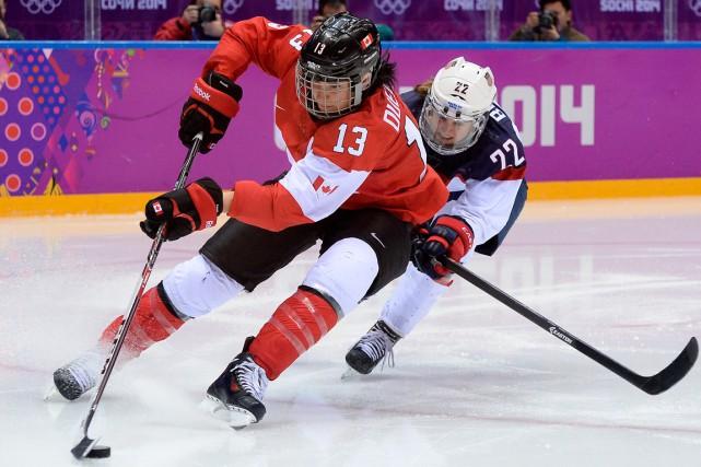 Pour Caroline Ouellette (13), quatre fois médaillée d'or... (Photo Jung Yeon-Je, AP)