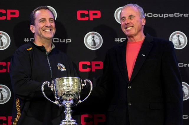 Les entraîneurs Kent Austin, des Tiger-Cats de Hamilton,... (Photo Paul Chiasson, PC)
