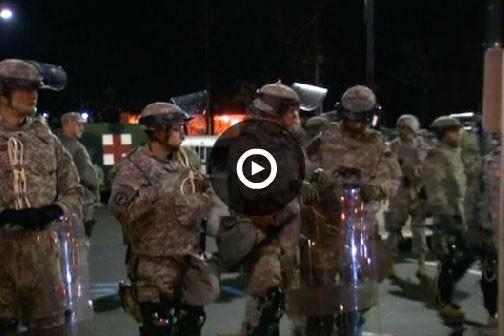 La présence de centaines de soldats de la Garde nationale dans les rues de...