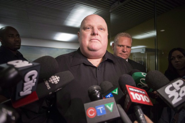 Rob Ford aux côtés de son frère, Doug, le 21... (PHOTO CHRIS YOUNG, ARCHIVES LA PRESSE CANADIENNE)
