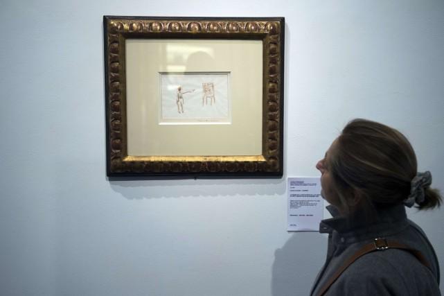 Une aquarelle du Petit Prince de l'écrivain français Antoine de Saint-Exupéry,... (Photo: AFP)