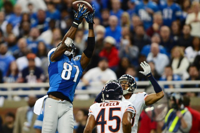 Calvin Johnson (81), des Lions, a échappé à... (Photo Andrew Weber, USA Today Sports)