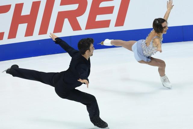 Eric Radford et Meagan Duhamel... (PHOTO TOSHIFUMI KITAMURA, AFP)