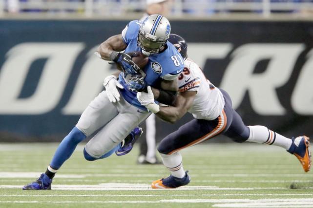 Calvin Johnson a finalement retrouvé sa touche après... (Photo AP)