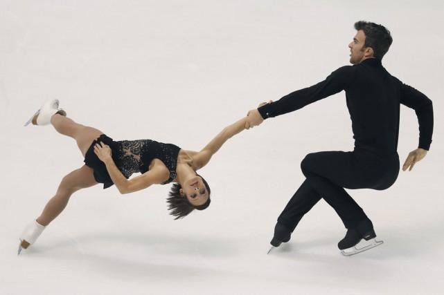 Meagan Duhamel et Eric Radford... (PHOTO SHIZUO KAMBAYASHI, AP)