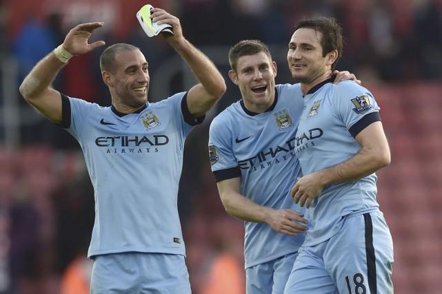 De gauche à droite: Pablo Zabaleta,James Milner etFrank... (PHOTO TOBY MELVILLE, REUTERS)