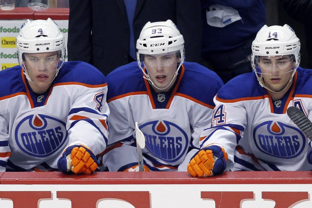 Taylor Hall (4), Ryan Nugent-Hopkins (93) et Jordan Eberle (14) ont été... (PHOTO BEN NELMS, ARCHIVES REUTERS)